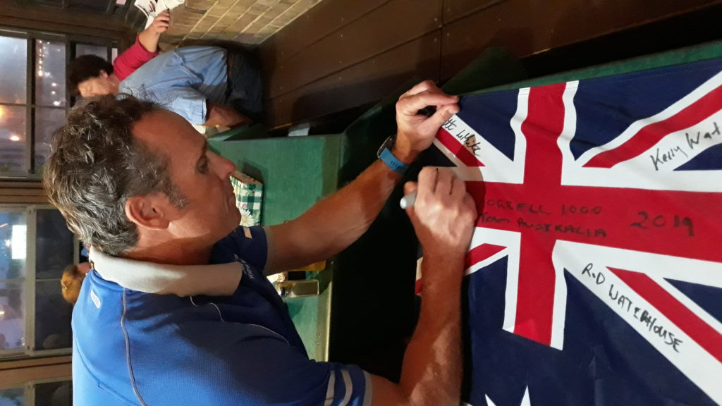 Beau White signs the Aussie flag